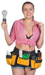 Woman in tool belt holding lamp bulb