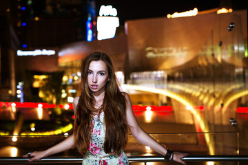 Sexy girl with windy hairs at night lights of Las Vegas