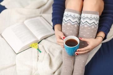 Female legs in warm woolen socks