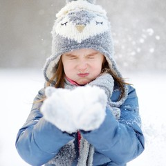 Funny little girl at winter