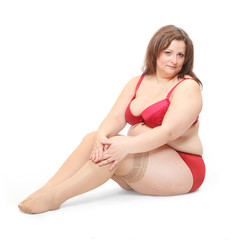 Overweight woman dressed in red undewear.