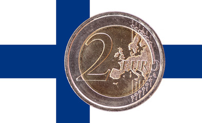 Common face of two euro coin on flag of Finland