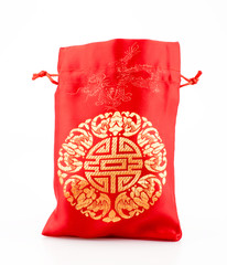 Red fabric bag or ang pow with Chinese style pattern on white ba