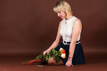 attractive woman in depression with a bouquet of roses