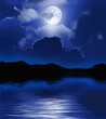 Night with moon and clouds over water