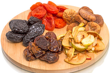 Dried fruits on kitchen board.