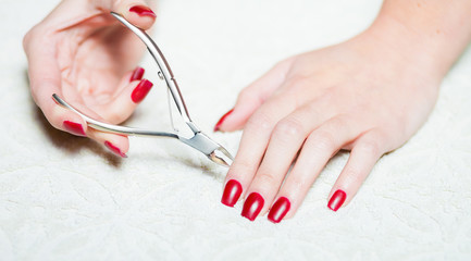 Woman hand manicure trimming cuticles