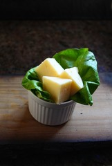 Cheddar cheese on a bed of lettuce in natural light