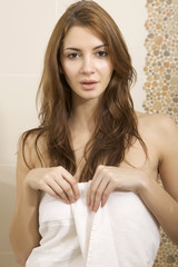 brunette woman in home bathroom