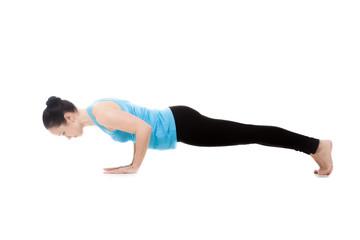 Yogi female in yoga pose Chaturanga Dandasana