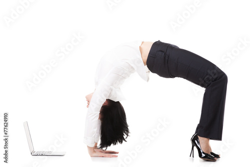 Young office woman standing in yoga Wheel or Upward-Facing Bow p - 77624910