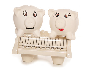 piggy banks sitting on a piano