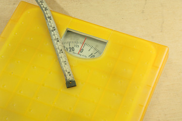 Weighting scales yellow