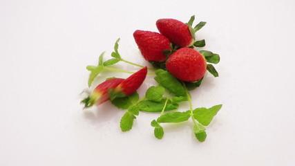 strawberry falling on fresh mint slow motion