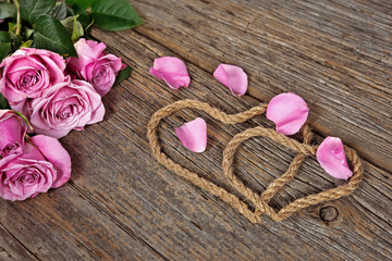 pink rose bouquet with rope hearts
