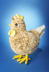 Handmade chicken on blue background