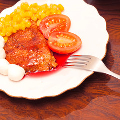 Dish with fried meat and sauce