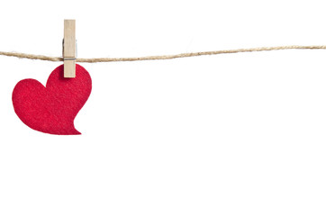 Red fabric hearts hanging on the clothesline . On white backgrou