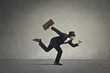 canvas print picture - Businessman running away
