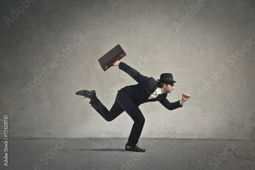 canvas print picture Businessman running away