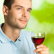 Handsome man with glass of redwine, outdoor