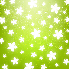Shiny flowers on green background