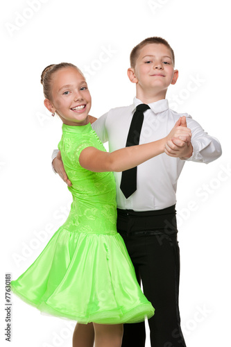Boy and girl are dancing together