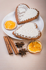White heart shape gingerbread cookies on  plate