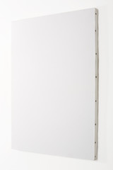 White blank canvas on white wall, clipping path