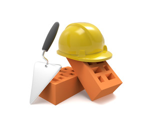 Stack of bricks and helmet