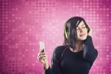 Joyous calm girl enjoying listening to music with headphones.