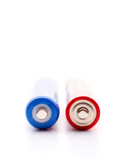Two batteries on a white background