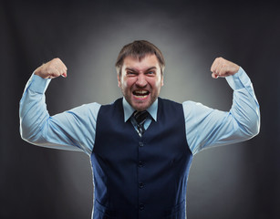 Businessman shows his muscles