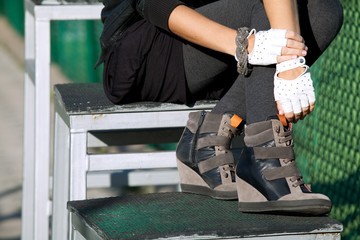 Stylish shoes and gloves on a young woman
