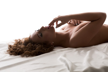 Image of passionate nude woman touching her lips
