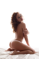 Sensual topless girl posing arching her back