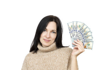 woman wearing beige sweater holding money isolated over white