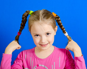 the young girl shows two braids