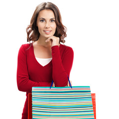 Woman in red casual clothing with shopping bags