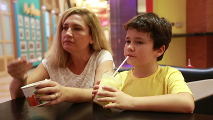 Mother sitting at the restaurant with her son