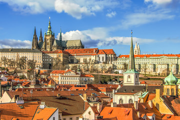 View at Prague roofs and towers and Prague Castle
