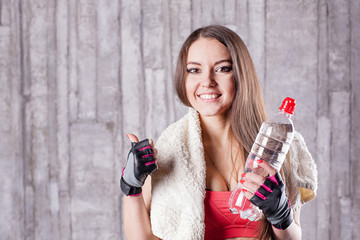 Fitness girl with bottle of water