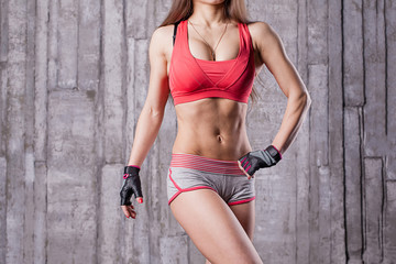Torso of athlette girl in gym