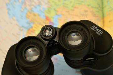Black binoculars with map