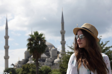 Woman on the Blue Mosque background