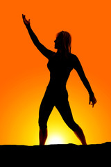 silhouette of woman stand one arm up one down