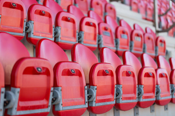 close up of folded up seats in football stadium