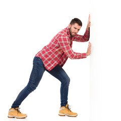Man pushing a white wall