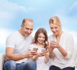 happy family with smartphones