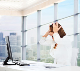 businesswoman screaming in front of computer